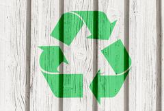 Recycling symbol on  wooden wall Stock Photos