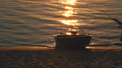 silhouette of  Fisherman and boat - stock footage