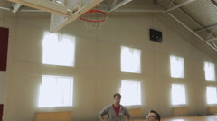Athlet with instructor throwing heavy ball in basket Stock Footage