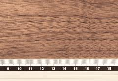 Ruler on wooden office desktop - stock photo
