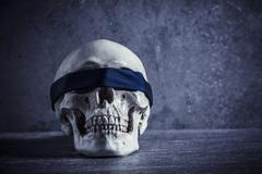 Human skull with blindfold Stock Photos