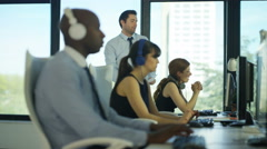 4K Customer service operators at work in city office with manager overseeing  Stock Footage