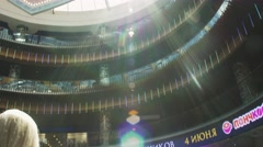 View of shopping center. Visitors sitting on chairs. Event. Sunny. Many floors Stock Footage