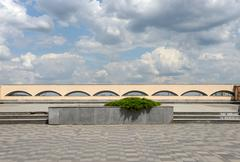 Scenic cloudscape above parapet of river embankment in Dnepropetrovsk, Ukrain - stock photo