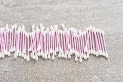 Cotton swabs, pink sanitary qtips. Stock Photos