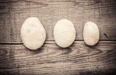 Stones on wooden background, concept of harmony and tranquility - stock photo