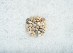 Small stones on stone background, concept of harmony and tranquility - stock photo