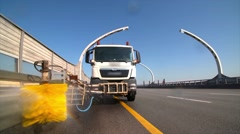 City road cleaning machine clearing road barriers in modern highway with water Stock Footage