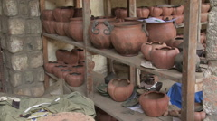 Cameroon Pottery, wide tilt up for shelf with ready pots Stock Footage