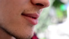 Portrait Of Gay mouth lips smiling with pencil - stock footage