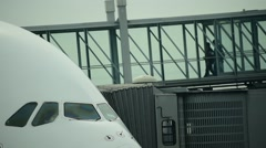 Pasengers boarding into an A 380 Airbus Stock Footage