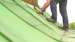 Man Working on the Roof, Sandering Paint Stock Footage