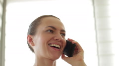 Portrait of young beautiful woman talking on mobile phone, close up HD - stock footage
