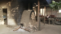 Cameroon Pottery, Full oven wide shot - stock footage