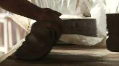 Cameroon Pottery, clay mixed and worked into a soft, plastic condition close up - stock footage