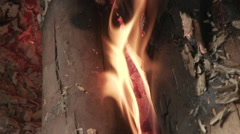 Cameroon Pottery, macro tilt up flame - stock footage