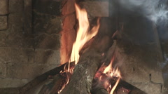 Cameroon Pottery, oven burning tilt up for smoke Stock Footage