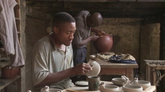 Cameroon Pottery, two potters working Stock Footage