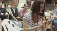 Girl use smartphone in shopping center other people applaud. Entertainment event - stock footage