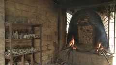 Cameroon Pottery, oven burning wide Stock Footage