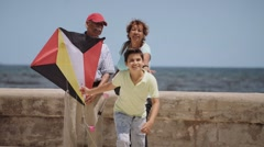 13-Family Boy And Grandparents Flying Kite Near Sea Slowmotion Stock Footage