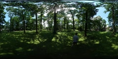 360Vr Video Man Walking by Grass in Park Trees Green Lawn Forest in Sunny Stock Footage
