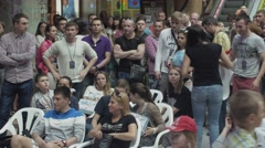 People stay and sit on chairs in shopping center. Entertainment event. Audience - stock footage