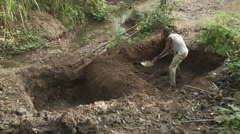 Cameroon Pottery, man digging clay in clay mine - stock footage