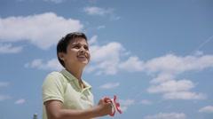 15-Happy Boy Flying Kite On Sunny Day Slowmotion Stock Footage