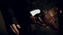 Closeup of cowboy opening coat and putting hand on pistol 4k Stock Footage