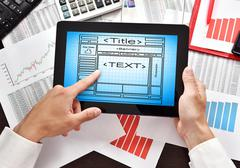 tablet with drawing web site - stock photo