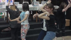 Girls dance in shopping center. Entertainment event. Dancing challenge - stock footage