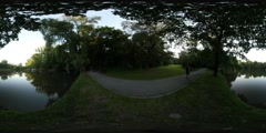 360Vr Video Man is Walking by the Footpath Road in the City Park Along the Stock Footage