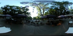 360Vr Video People at Cafe Outdoors in Park Decorated With Paper Balls Sunset Stock Footage