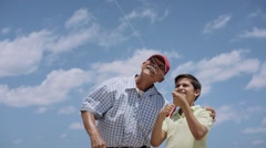 18-Family Grandpa Teaching Boy To Fly Kite Slowmotion - stock footage