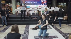 Girls depict how men sleep in shopping center. Entertainment event. Challenge - stock footage