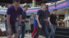Boys depict drunk women in shopping center. Entertainment event. Challenge Stock Footage