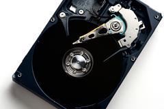 Computer sata hard disk drive disassemble Stock Photos