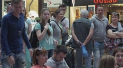 Boy come for coupon to woman in shopping center. Entertainment event. Winner Stock Footage