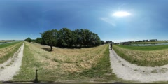 360Vr Video Cyclist is Riding by the Road Spherical Panorama Man on the Field Stock Footage