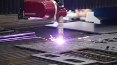 Machine for constant metal laser cutting - stock footage