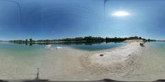 360Vr Video Man is Sitting on Sandbar at Water Spherical Panorama Sky is Stock Footage