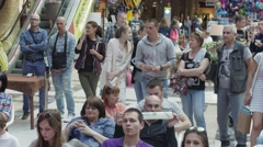 Many people sit on chairs in shopping center. Entertainment event. Children - stock footage
