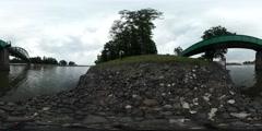 360Vr Video Man at River Bank Stones Near Water Bridge Through River Young Man Stock Footage