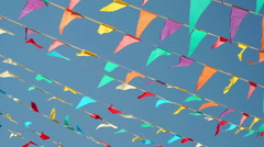 String Pennant Flags Against Blue Sky Stock Footage