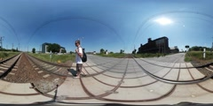 360Vr Video Man Walking Slowly Crossing Railroad Railway Station Buildings Cars Stock Footage
