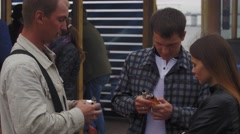 Men with electronic cigarette speaking on street. Fair. Vapers. Smoking. Smokers Stock Footage