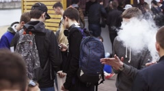 People smoke electronic cigarettes on street fair. Vapers festival. Steam. Crowd Stock Footage
