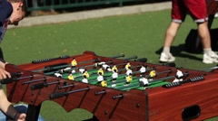 Boys playing table football (soccer Stock Footage