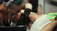 Tattooing on the body. Tattoo artist make tattoo in studio Stock Footage
